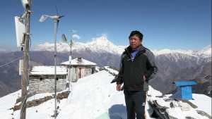 Mr. Mahabir Pun inspecting a wireless relay station.